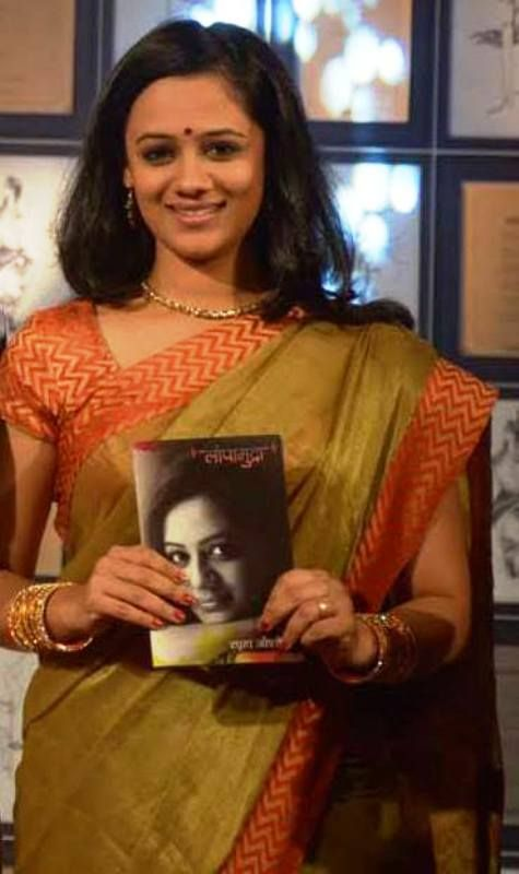 Spruha Joshi Posing with Her Book