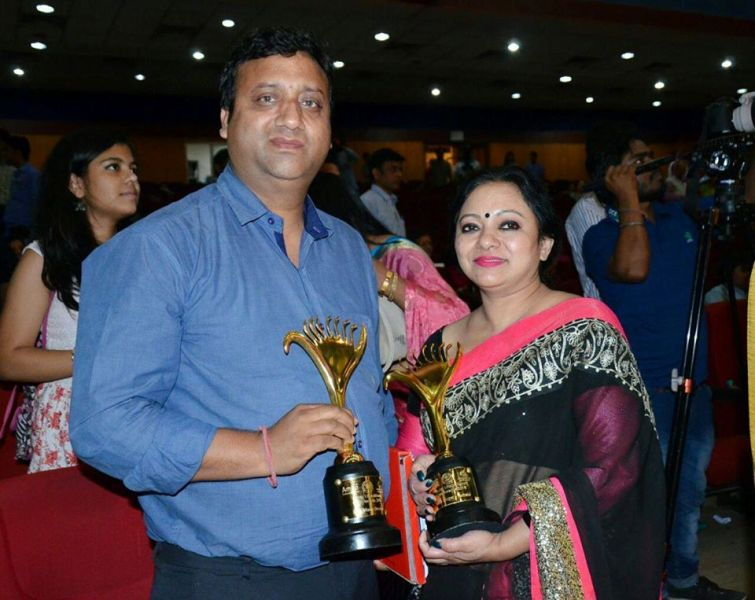 Young Uttarakhand Cine Award Posing with her Husband and Young Uttarakhand Cine Award