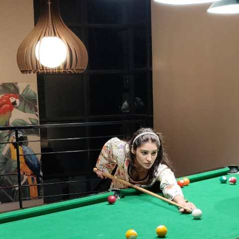 Yukti Thareja playing pool