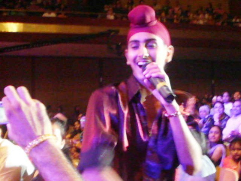 An Old Picture of Rohanpreet Singh Performing on Stage