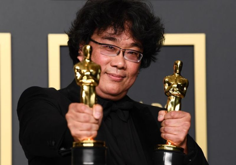 Bong Joon-ho Posing with his Oscars