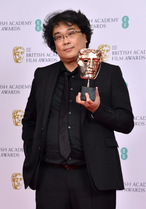Bong Joon-ho with his British Academy Film Awards
