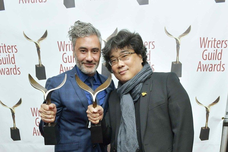 Bong Joon-ho with his Writers Guild of America Awards