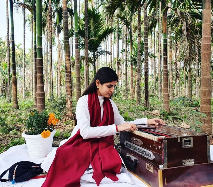 Devi Chitralekha Playing the Harmonium