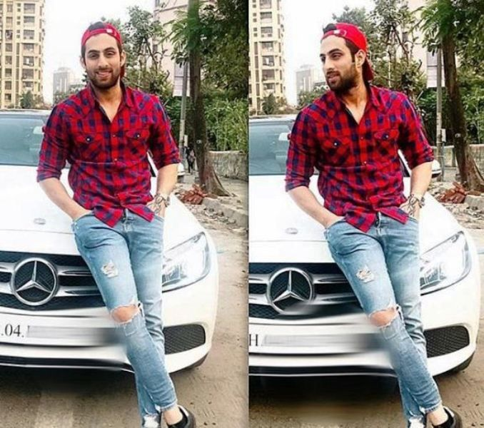 Mayur Verma Posing with His Car