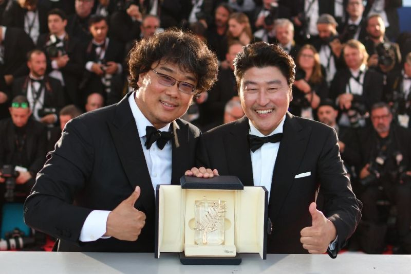 Song Kang-ho and Bong Joon-ho with Palme d'Or at the Cannes Film Festival