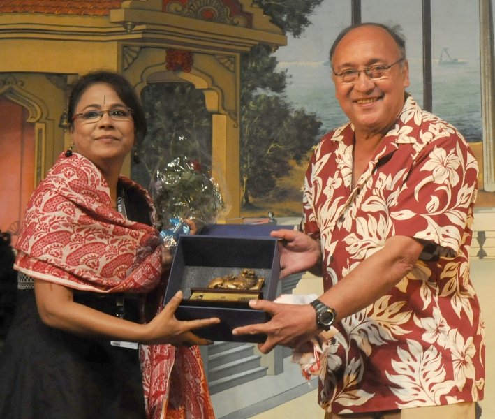 The International Jury Member Victor Banerjee felicitating the Assamese Film Actress Seema Biswas, at the Closing Ceremony of the North East Films, during the 44th International Film Festival of India