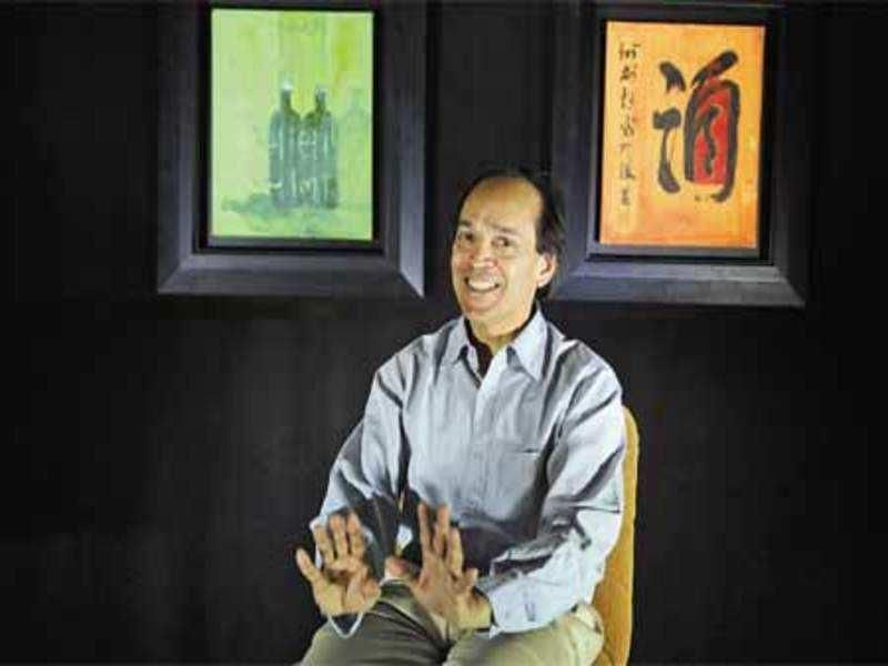 Vikram Seth with his Paintings