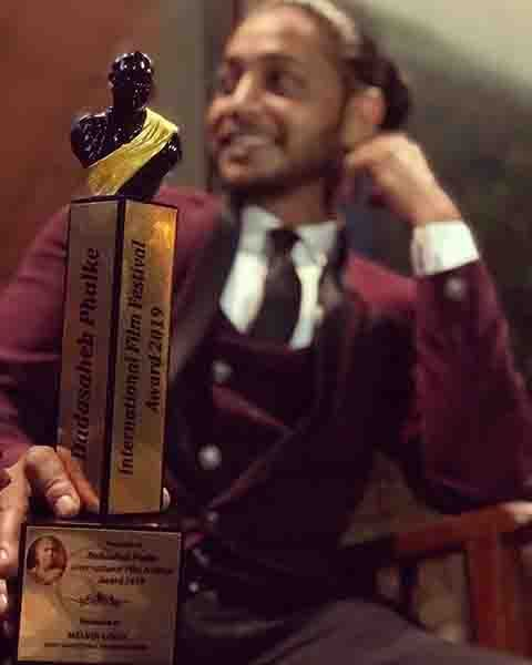 Melvin Louis Posing with his Dadasaheb Phalke IFF Award