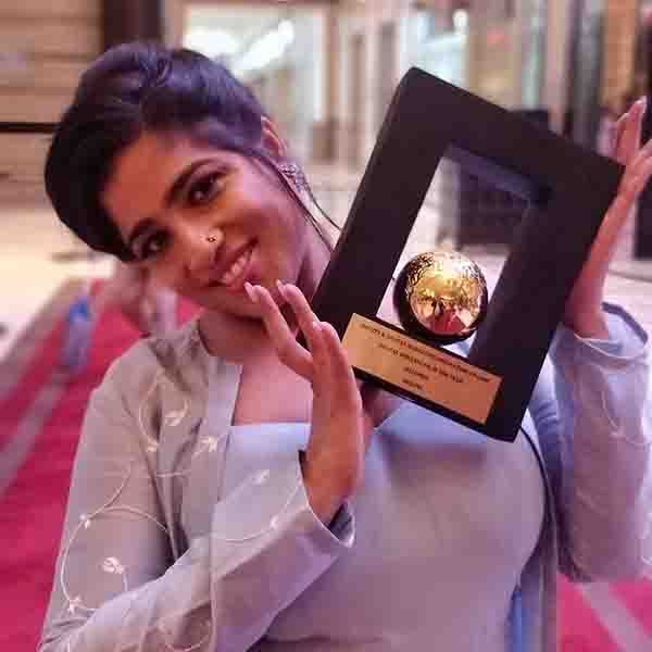 RJ Malishka with Her Award