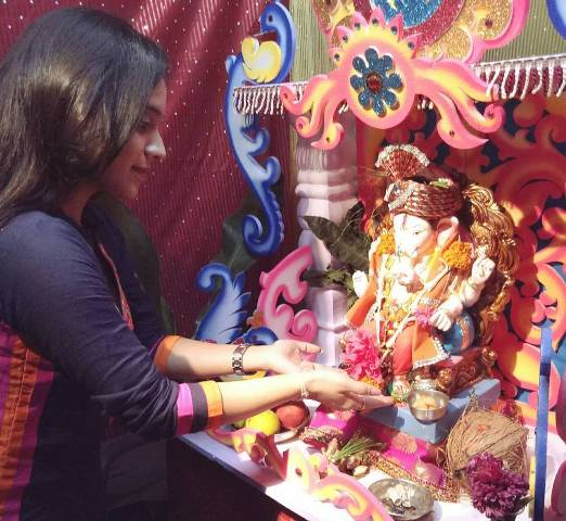 Rutuja Junnarkar with the idol of Lord Ganesha
