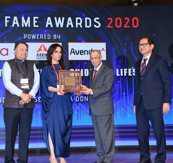 Anita Dongre receiving an award