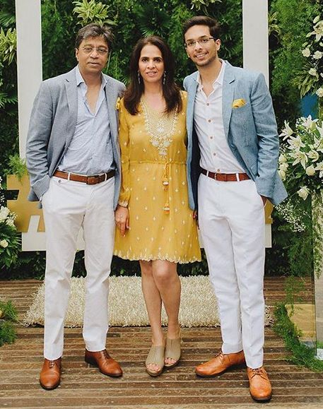 Anita Dongre with her husband and son