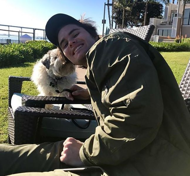 Chase Stokes with his Dog