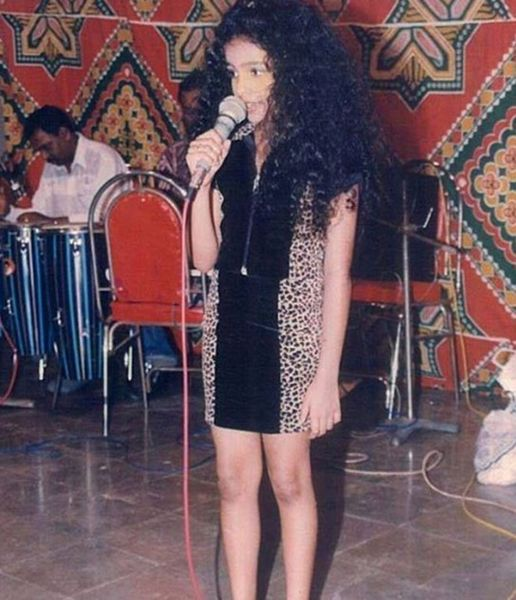 Childhood Picture of Sanah Moidutty Performing on a Show