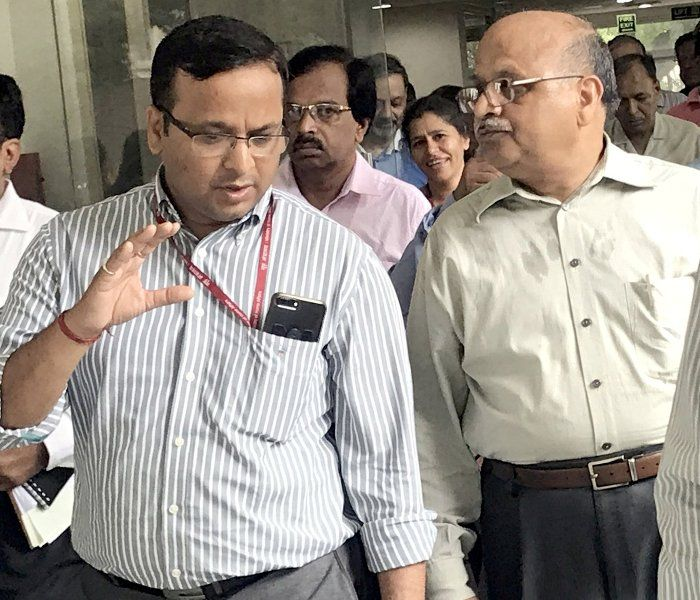 Lav Agarwal interacting with one of his colleagues