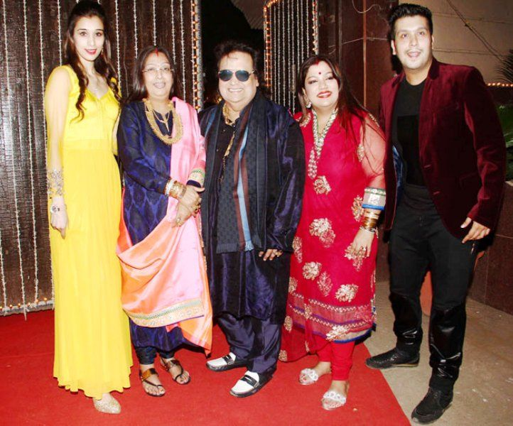 Bappi Lahiri With His Son, Daughter, Wife, and Daughter-in-law (from left)