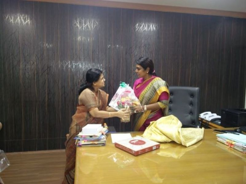Beela Rajesh Greeted by a Colleague in Her Office