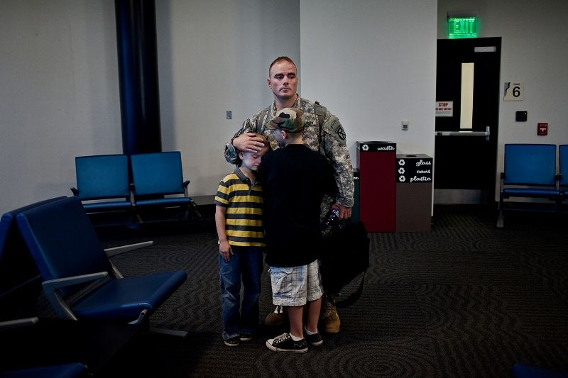 Brian Eisch and his sons before his flight departs from Appleton in Wisconsin