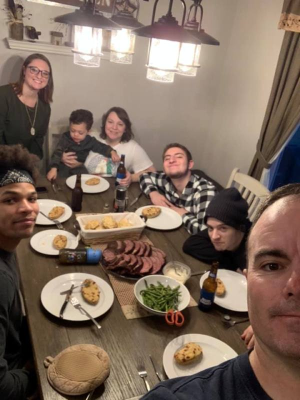 Brian Eisch at a dinner party with his family and friends