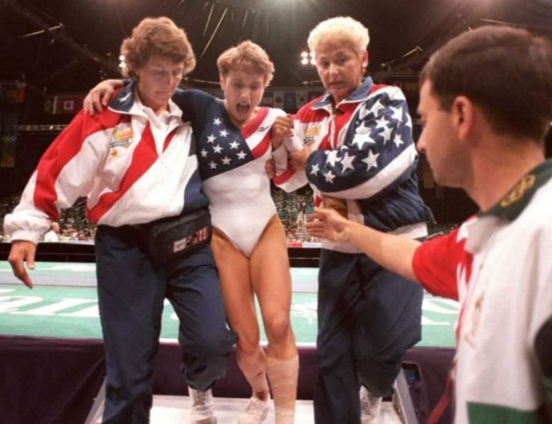 Larry Nassar extending his hand to help the U.S. gymnast Kerri Strug during the 1996 Atlanta Olympics