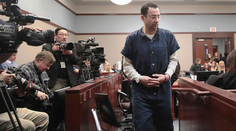 Larry Nassar entering in a court