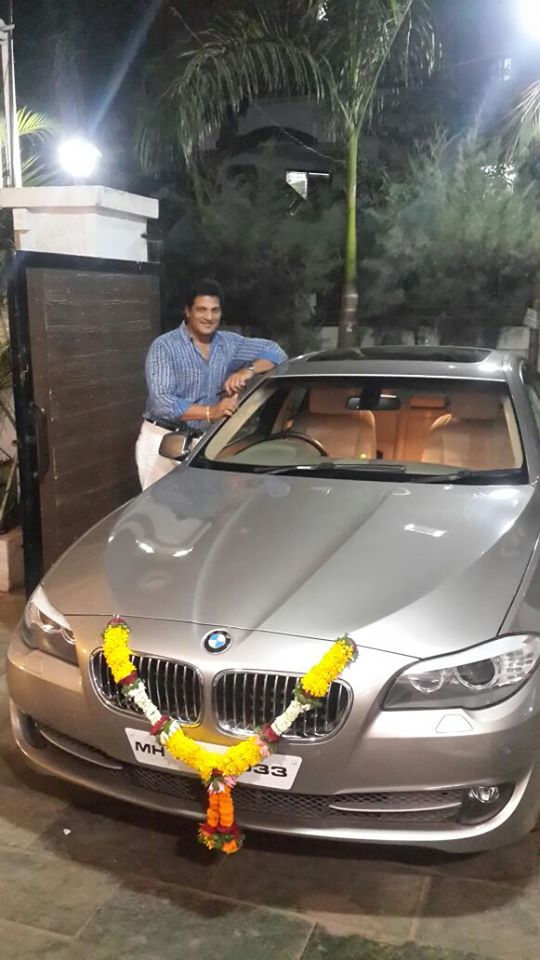 Mahendra Murlidhar Ghule with his BMW
