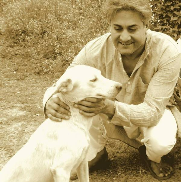 Sarvadaman D Banerjee Playing With a Dog