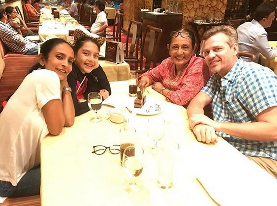 Suchitra Pillai with her mother, husband, and daughter