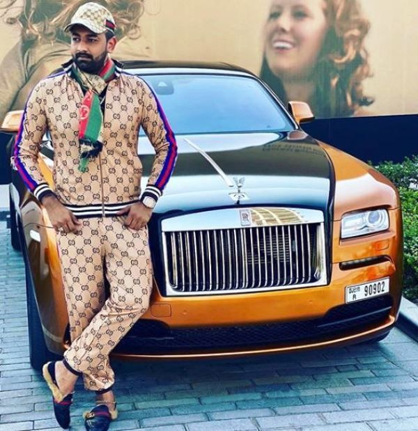 Asad Ravjani Posing With His Car