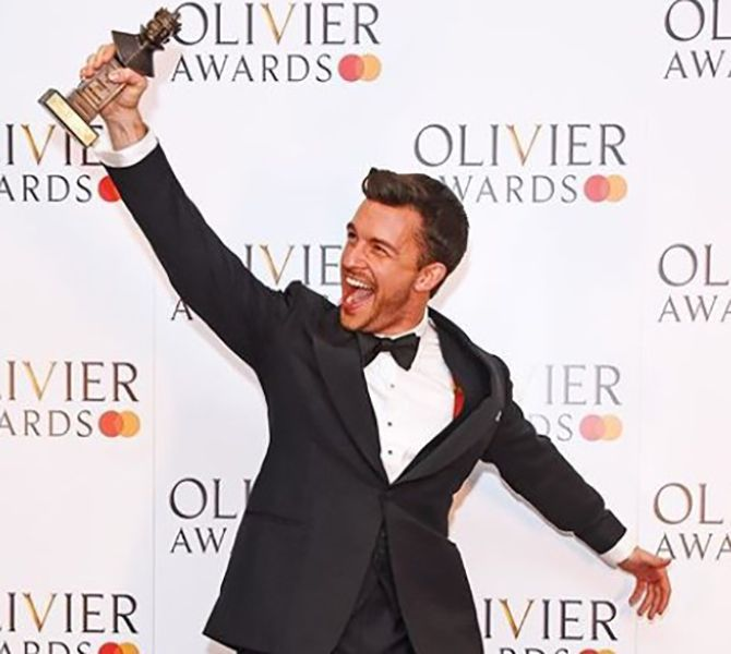 Jonathan Bailey with his Olivier Award