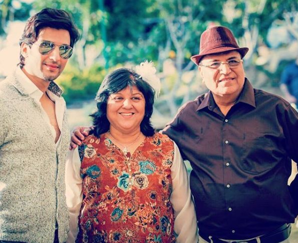 Manish Raisinghan and his parents