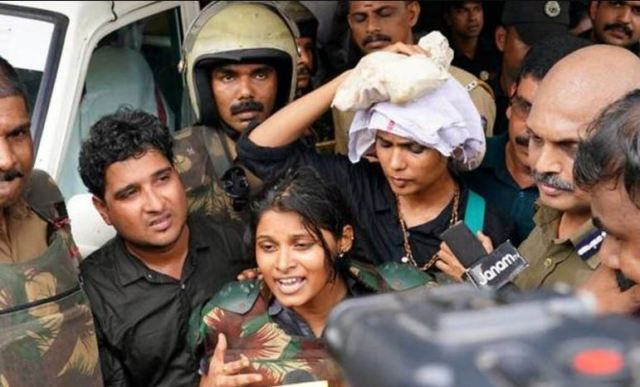 Rehana and journalist Kavitha Jakkal walking out of the temple Sabrimala