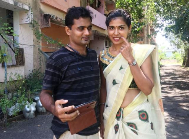 Rehana with her partner Manoj outside her residence