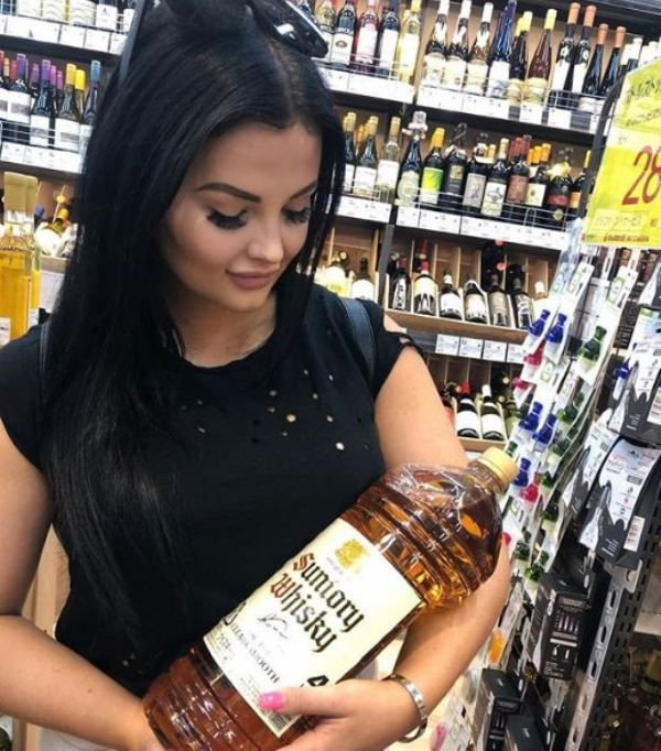 Renee Gracie holding a bottle of whisky