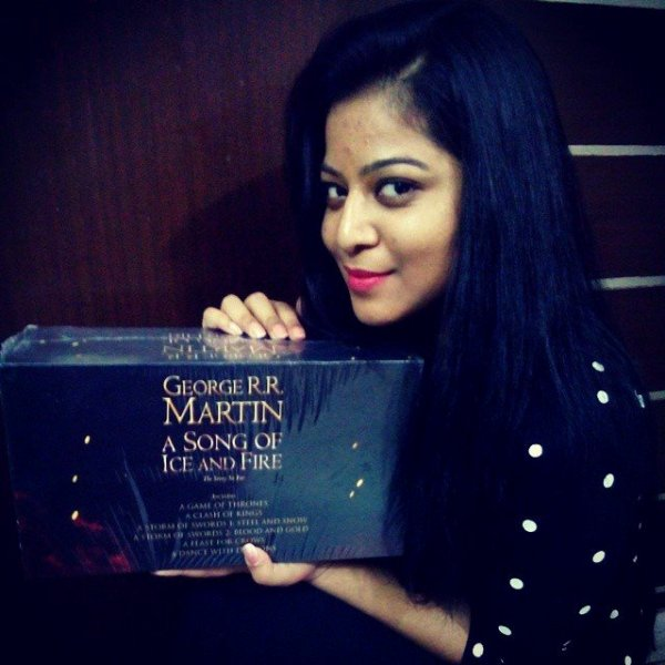 Safoora Zargar Holding of Box of George R. R. Martin's Bestsellers