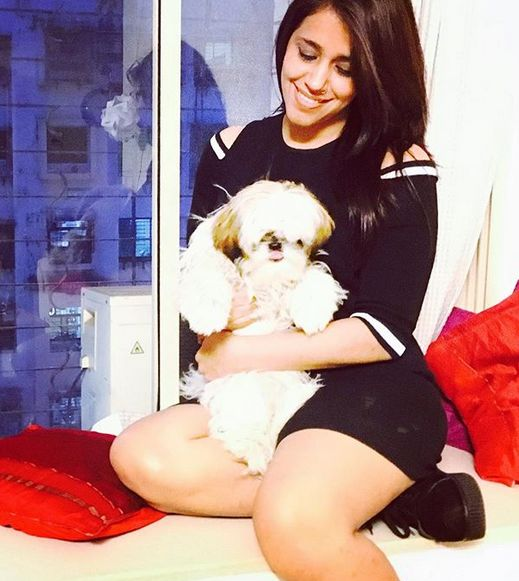 Taranjit Kaur with her pet dog