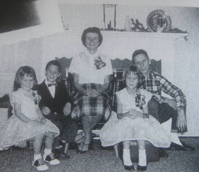 Ted Bundy (2nd from left) sits with his mother and his three step-siblings in their family home in Tacoma