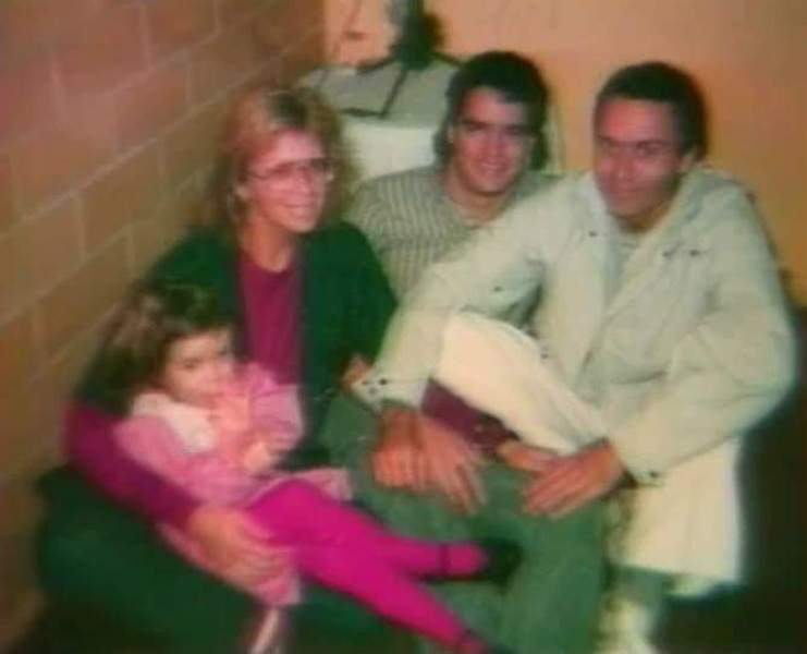 Ted Bundy (right) and Carol Anne Boone (holding Rose Bundy in her lap)