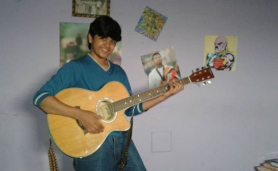Vishesh Bansal playing the guitar