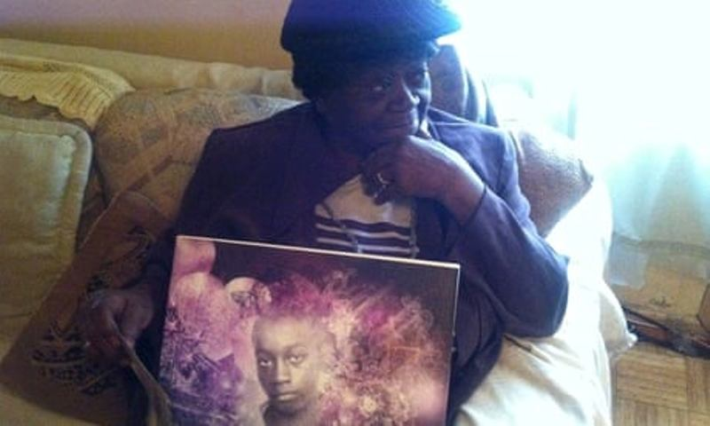 Aime Ruffner with a portrait of her brother, George Stinney Jr.