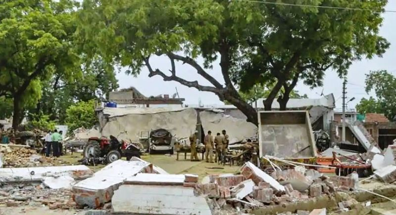 Debris lie on the ground after demolition of the house of gangster Vikas Dubey, in Kanpur