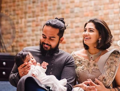 Disha Madan with her husband and son