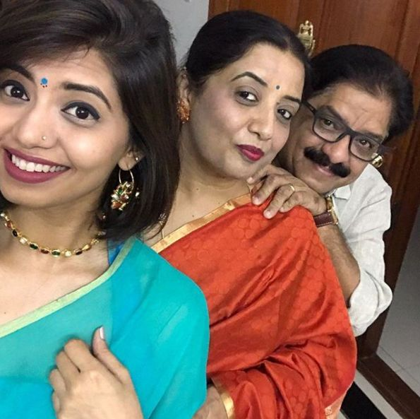 Disha Madan with her parents