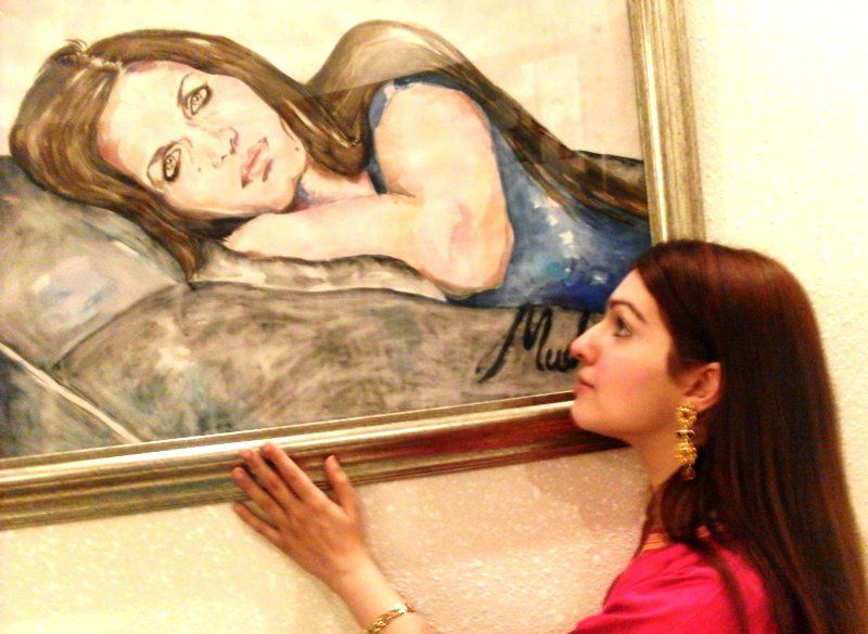 Mushaal Mullick posing beside her mother's painting