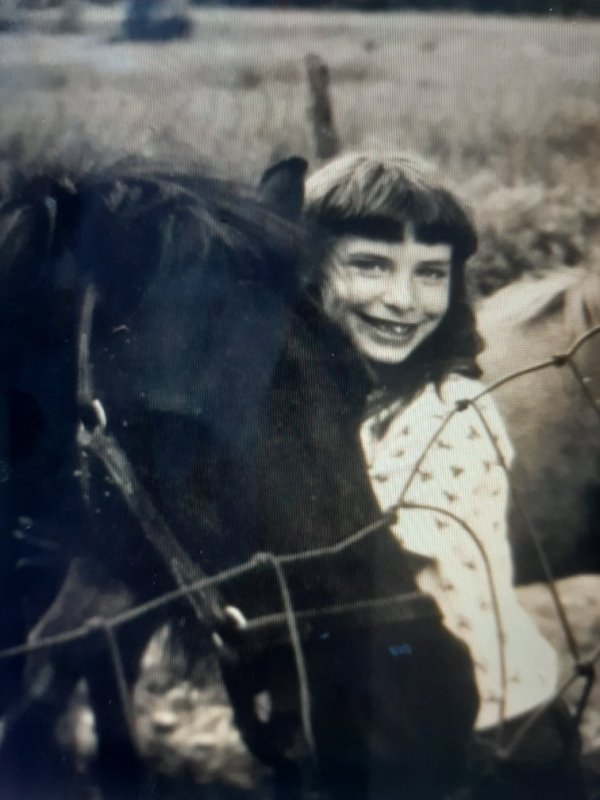 Tara Reade Playing With a Horse
