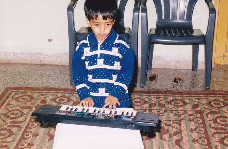 An Old Picture of Yashraj Mukhate Playing the Piano