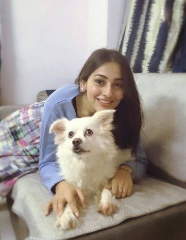 Anagha Bhosale with her pet dog