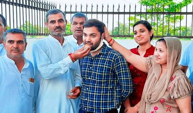 IAS Topper Pradeep Singh along with his family member
