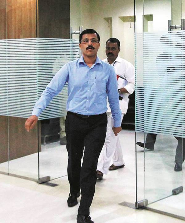 IAS Tukaram Mundhe walking out of his office